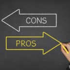 Pros and cons arrows on blackboard
